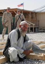 Marines from the 24th Marine Expeditionary Unit (24th MEU), NATO International Security Assistance Force (ISAF), oversee the Afghanistan workers while they construct platforms and flooring that will be used as a solid base for the 24th MEU's tents at the U.S. National Command Element (NCE) while in the RC South region of Afghanistan. The 24th MEU will use these tents for office spaces and operating centers while in the region in support of NATO. (US Marine Corps photo by Corporal Andrew J. Carlson)