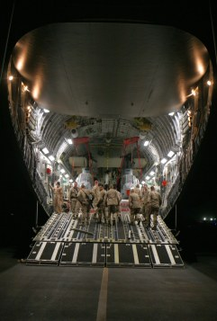 Marines from Medium Marine Helicopter Squadron 365 (reinforced) (HMM 365), 24th Marine Expediontary Unit (24th MEU), NATO International Security Assistance Force (ISAF), unload gear and AH-1W Super Cobra Helicopters from an Air Force C-17 Cargo Plane. These aircraft will contribute to the mission of the 24th MEU while in the RC South region of Afghanistan in support of NATO. (US Marine Corps photo by Corporal Andrew J. Carlson)
