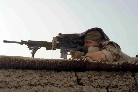 HELMAND PROVINCE, Afghanistan Marines with Charlie Company, 1st Battalion, 6th Marine Regiment, 24th Marine Expeditionary Unit, NATO International Security Assistance Force, operating in Garmsir. (Official Marine Corps photograph by Cpl. Andrew J. Carlson)
