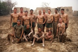 Marines from Charlie Company, Battalion Landing Team 1st Battalion 6th Marine Regiment, 24th Marine Expeditionary Unit, NATO International Security Assistance Force, take advantage of the only rainstorm since they arrived in Afghanistan five months ago. The Marines played football, wrestled and started mud fights, Aug. 2. (Official Marine Corps photograph by Cpl. Andrew J. Carlson)