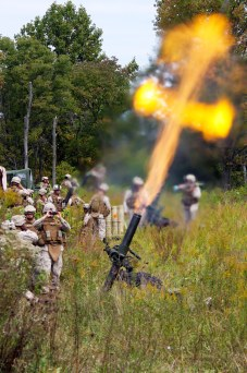 U.S. Marine mortarmen from 120mm mortar platoon, Bravo Battery 1/10, attached to Battalion Landing Team 1st Battalion, 9th Marine Regiment, 24th Marine Expeditionary Unit conduct fire missions during the 24th MEU's Realistic Urban Training at Camp Atterbury, IN September 29, 2009. The 24th MEU will use these mortarmen in support of BLT 1/9 in hostile areas to neutralize threats by conducting similar fire missions should the need arise while they are on their upcoming deployment. (U.S. Marine Corps photo by Sgt Andrew J. Carlson)