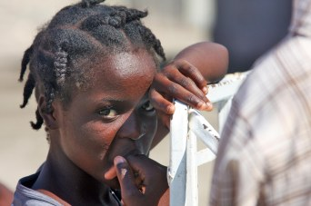 A Haitian child looks on as a team sent out by the 24th Marine Expeditionary Unit assesses the town of Grand Saline, Haiti Jan 25. This team of Marines and Sailors was sent to determine what could be done to assist in Operation Unified Response. (U.S. Marine Corps photo by Sgt Andrew J Carlson)