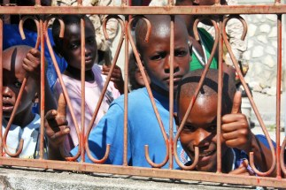Haitian children excitedly watch the Marines and Sailors from the 24th Marine Expeditionary Unit and Nassau Amphibious Ready Group walk through the town of Cavaillon, Haiti while conducting a site survey Jan 28. This group of Marines and Sailors were sent to assess a multitude of things including medical readiness, power supply, food and water availability, and infrastructure after the recent earthquake in Haiti. (US Marine Corps photo by Sgt Andrew J. Carlson)