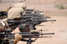 The Marines of Headquarters and Support Company, Battalion Landing Team 1st Battalion, 9th Marine Regiment, 24th Marine Expeditionary Unit, take part in a live fire range in Djibouti, Africa March 10. This range, part of a 3 day training evolution ending with the take down of a bunker or strongpoint, will familiarize and track the proficiency of individual Marines with their weapons. (US Marine Corps photo by Sgt Andrew J Carlson)
