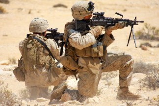 On April 20, Cpl Gorton, Team Leader, and LCpl Savatano, Squad Automatic Weapon Gunner, of 3rd Platoon, Bravo Company, Battalion Landing Team, 1st Battalion, 9th Marine Regiment, 24th Marine Expeditionary Unit, unload rounds into targets while taking part in a platoon size attack during a training scenario in the Middle East. The attack is the conclusion to a training evolution the Marines have been participating in since the beginning of April. (US Marine Corps photo by Sgt Andrew J. Carlson)