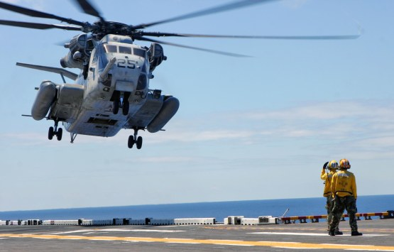 Marines and Sailors aboard the USS Iwo Jima carry out flight operations while on the 2006-2007 deployment with the 24th Marine Expeditionary Unit (MEU). (US Marine Corps photo by Lance Corporal Andrew Carlson)